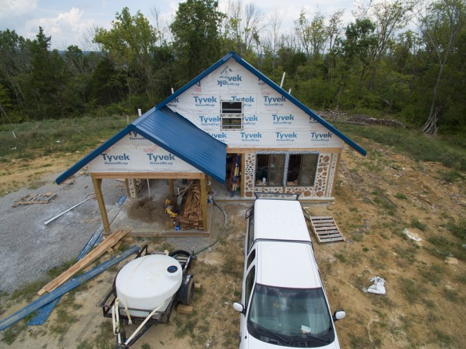 South face of our cordwood house, still in the process of being built - accidentalhippies.com