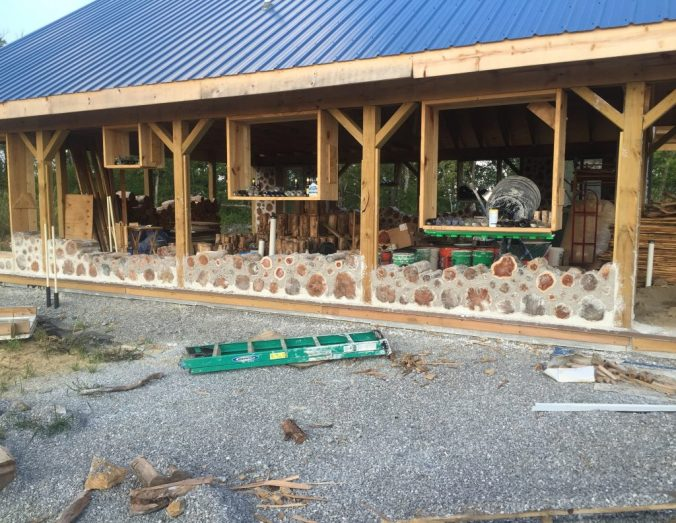 Cordwood wall in progress - at Accidental Hippies