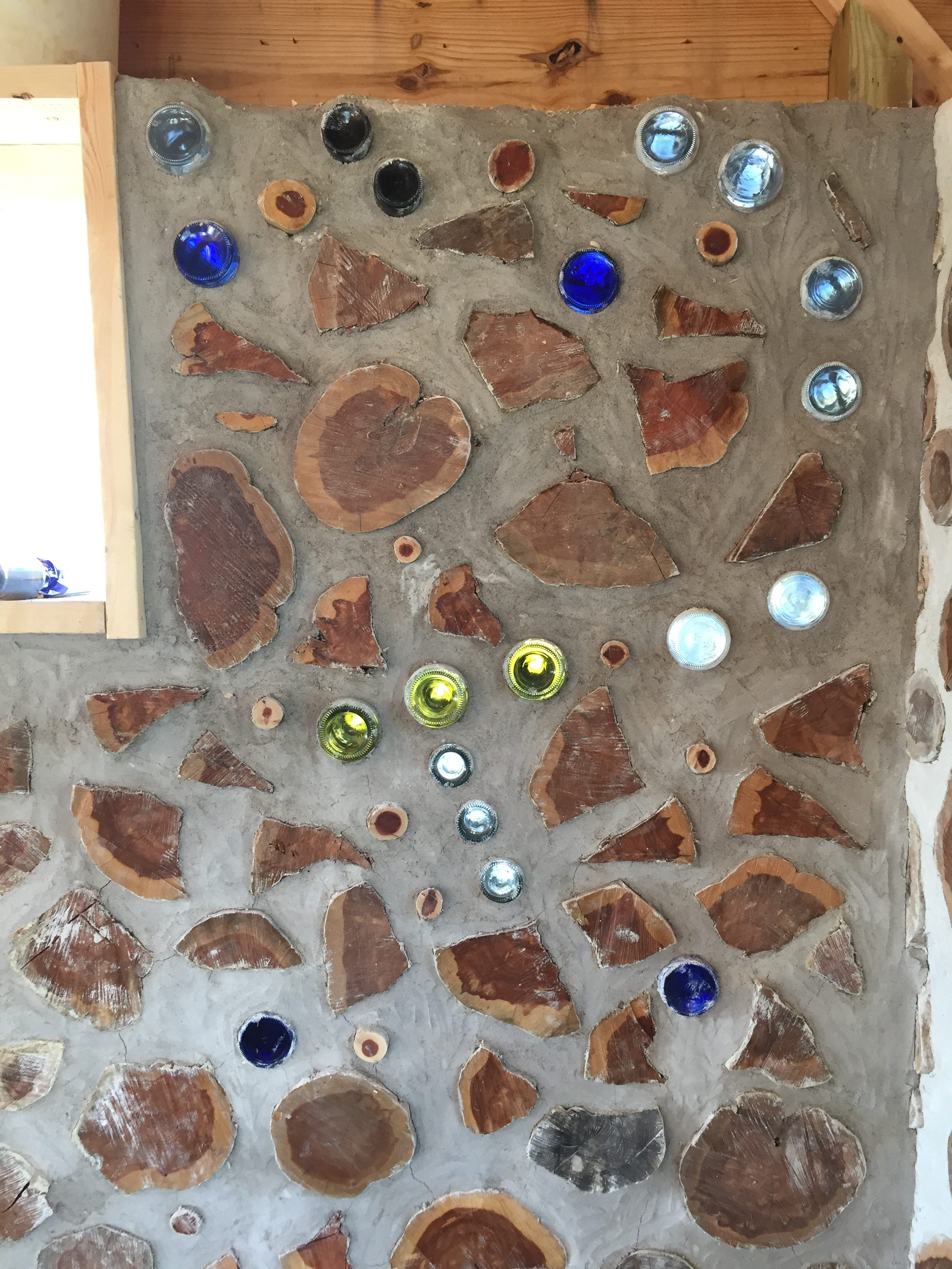 You can use bottles in a cordwood wall to make constellations. Here is the constellation Orion.