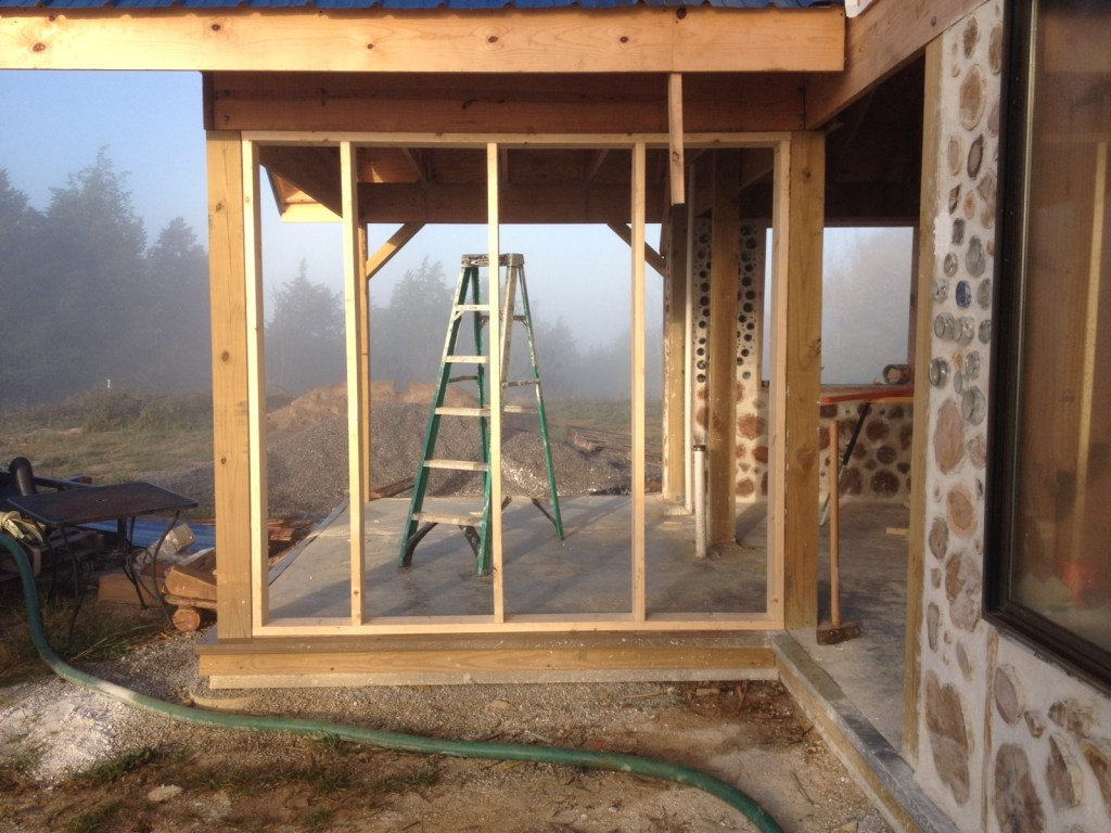 2x6 Stud framed wall set between 6x6 posts in a pole frame house