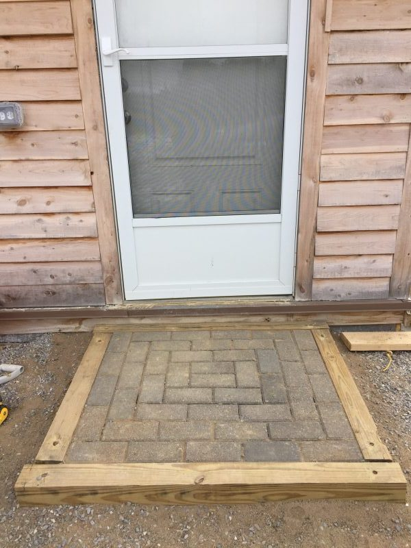 We built a simple paver step out of leftover pressure treated timbers, free paver bricks, and rebar. See more projects as we finished our cordwood house here.