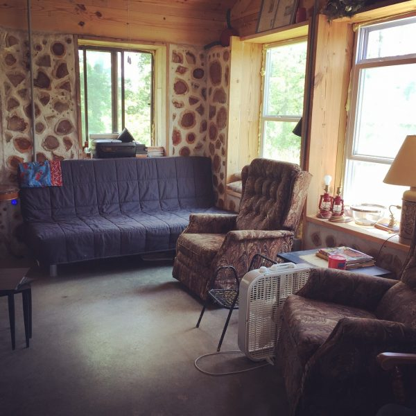 The living room in our cordwood house. Find out more about how we built it here. #cordwood #homesteading #offgrid