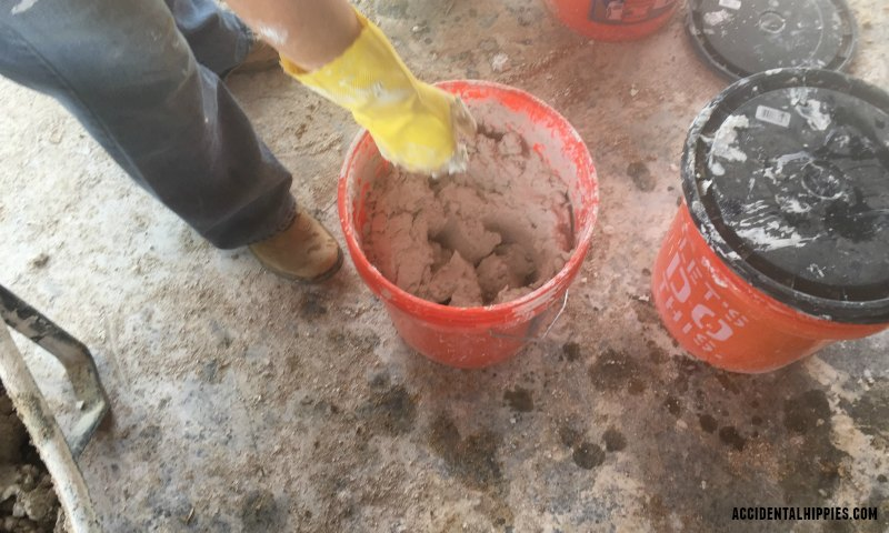 Mixing lime putty for making cordwood mortar. Learn more about how we make our cordwood mortar here.