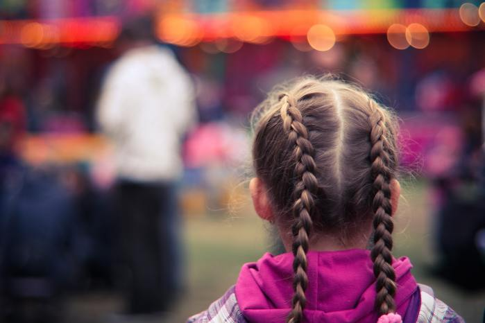 Back of a girl's head, girl has braids and is facing a blurred background scene. The Best Tips to Give Your Hair Volume