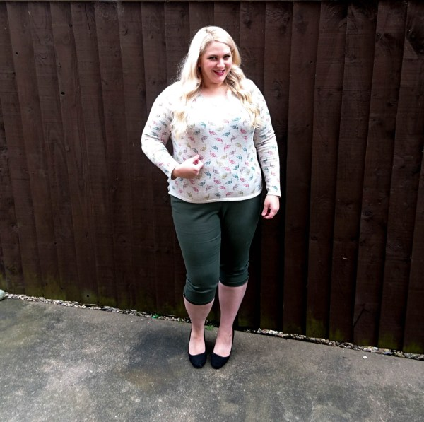Me posing in pretty peahen jumper paired with dark green cropped trousers and heels for season transition