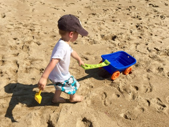 Memorable Family Holiday boy playing on beach