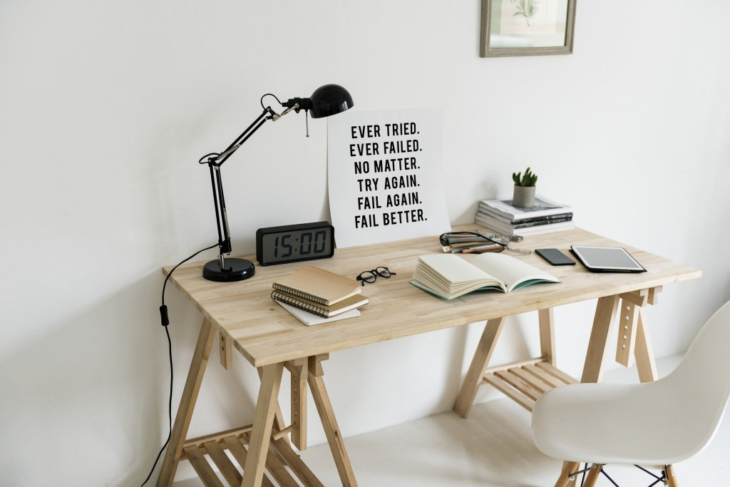 "No More Excuses - desk space with a white chair, black lamp, some books and a little post that says ""Ever Failed. Ever tried. No matter. Try again. Fail again. Fail better"" (which I'm not really sure is a bit lame or kind of cool)"