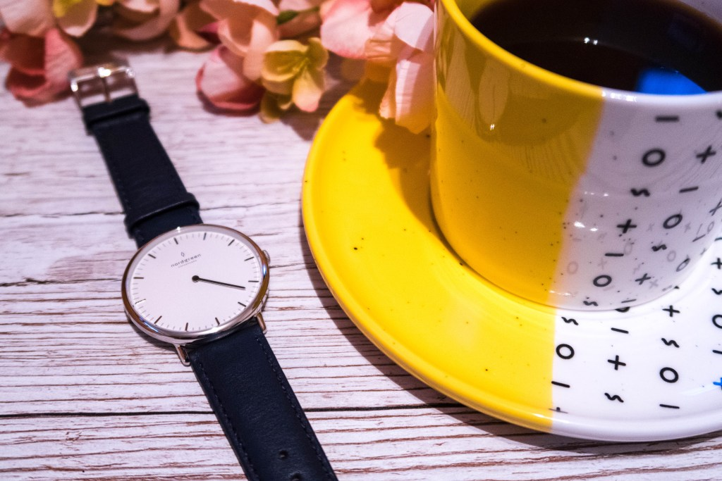 Nordgreen Native minimalist ladies watch next to a yellow cup containing coffee