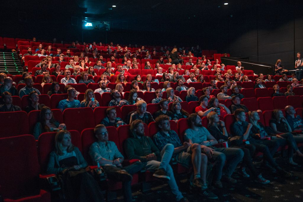 inside a cinema with people in seats