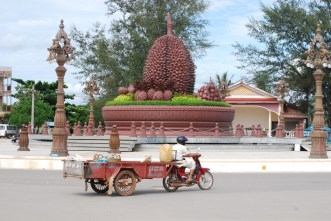 "The durian roundabout. The bike is pulling a ""country bus"" cart."