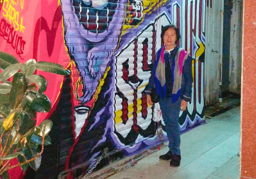 Image-of-Helen-Wong-in-front-of-HKwalls-mural