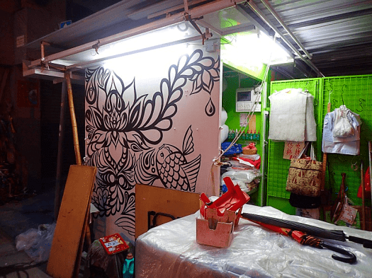 Image-of-hkwalls-mural-on-the-wall-of-a-stallnon-a-street-market-in--Hong-Kong