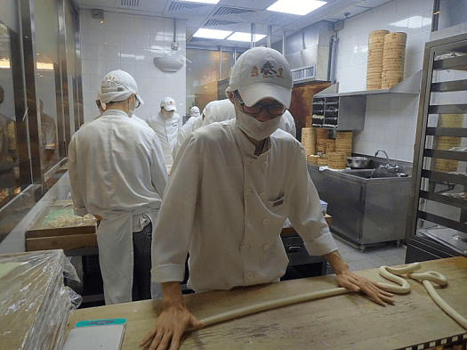 Image-of-chef-rolling-out-dough-at-Chinese-restaurant-in-Hong-Kong-credit-atwhk