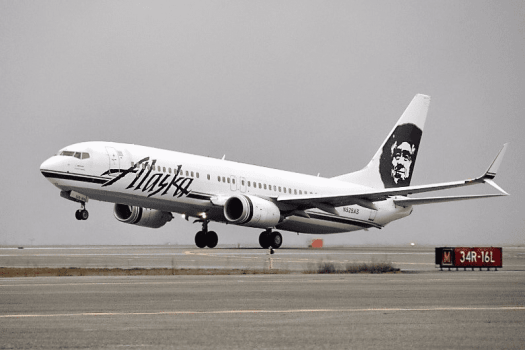 Alaska Airlines jetliner taking off from Seattle International Airport.