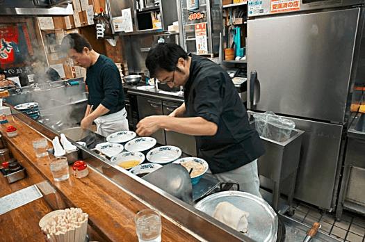 chefs-preparing-ramen-in-sapporo-restaurant-credit-www.accidentaltravelwriter.net