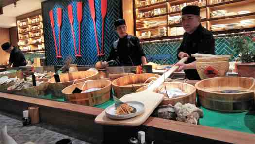 image-of-Japanese-chef-serving-fish-on-a-wooden-paddle