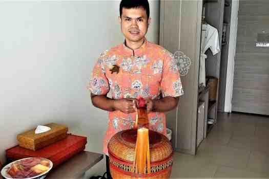 image-of-proud-phuket-thailand-hotel-staff-holding-basket