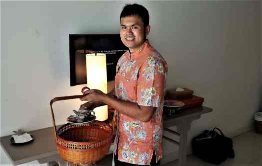 image-of-proud-phuket-thailand-hotel-staff-serving-tea