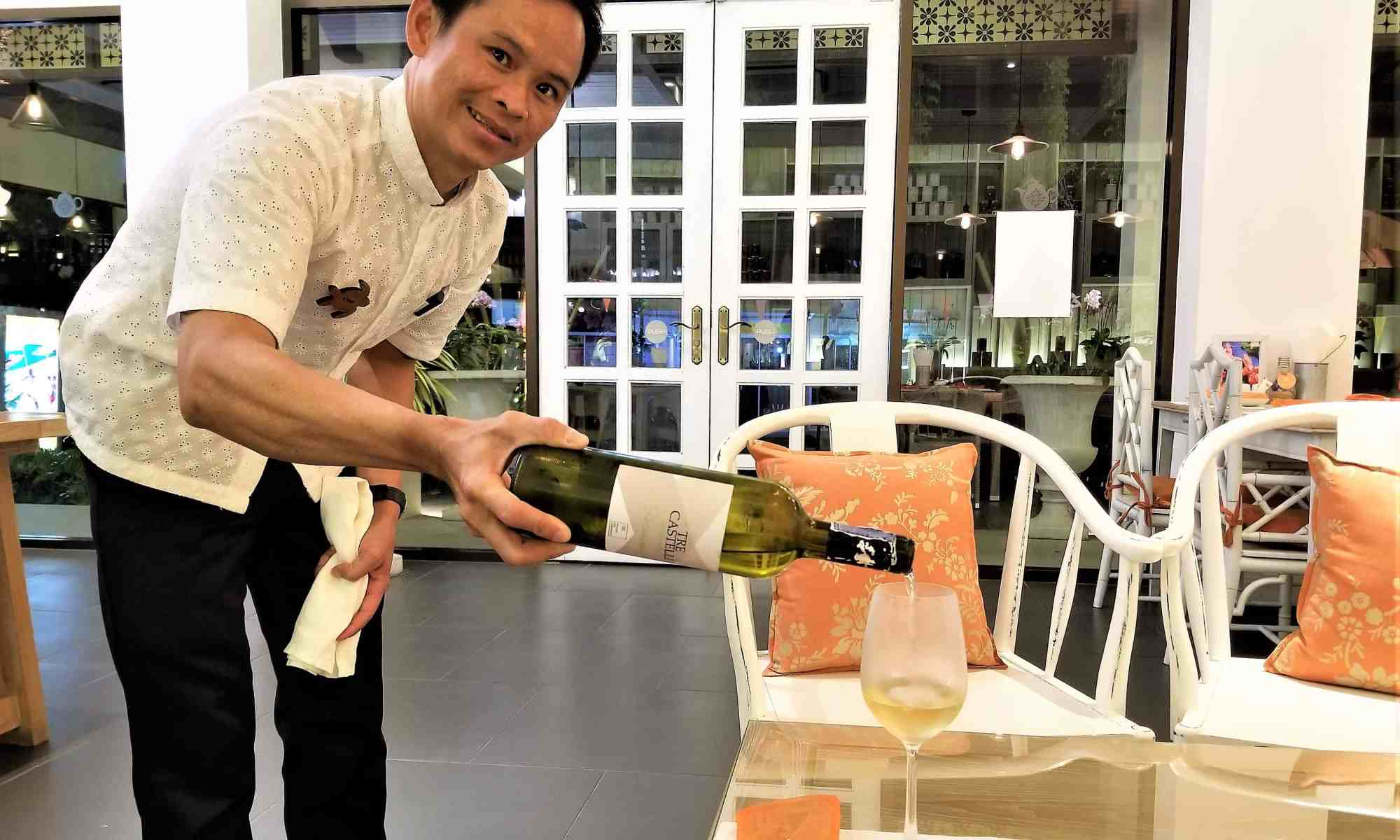 image-of-waiter-pouring-wine-at-ang-ku-tea-house-at-proud-phuket-hotel-thailand