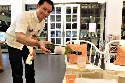 image-of-waiter-pouring-wine-at-ang-ku-tea-house-at-proud-phuket-hotel-thailand