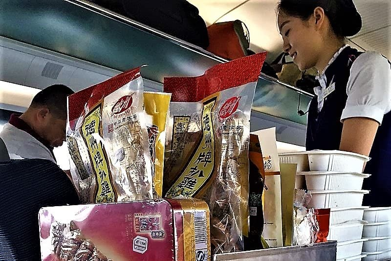image-of-flight-attendant-selling-snacks