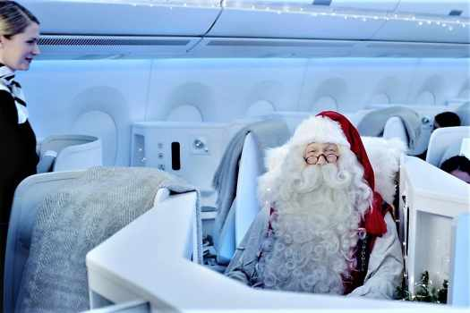 santa claus flying aboard finnair