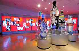 World of Coca-Cola—Folk Art Bottles