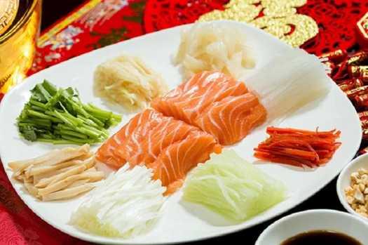 Tao Li Chinese restaurant in Hong Kong serves traditional Lo Hei with salmon sashima and abalone