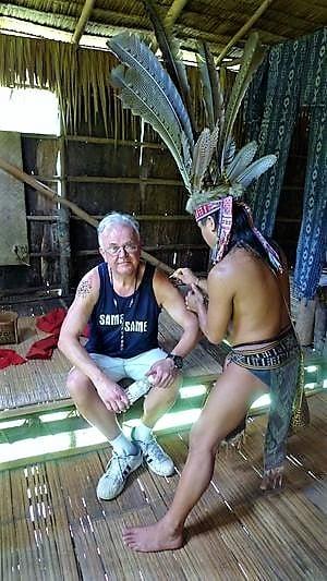 tour-guide-applying-tattoos-to-tourist