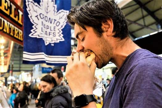 foodie-eats-sandwich-at-st-lawrence-market-in-downtown-toronto