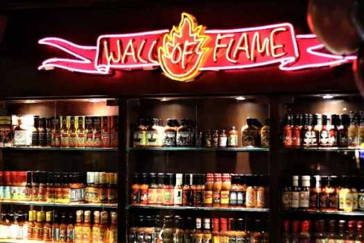wall-of-flame-hot-sauce-display-at-coyote-in-hong-kong