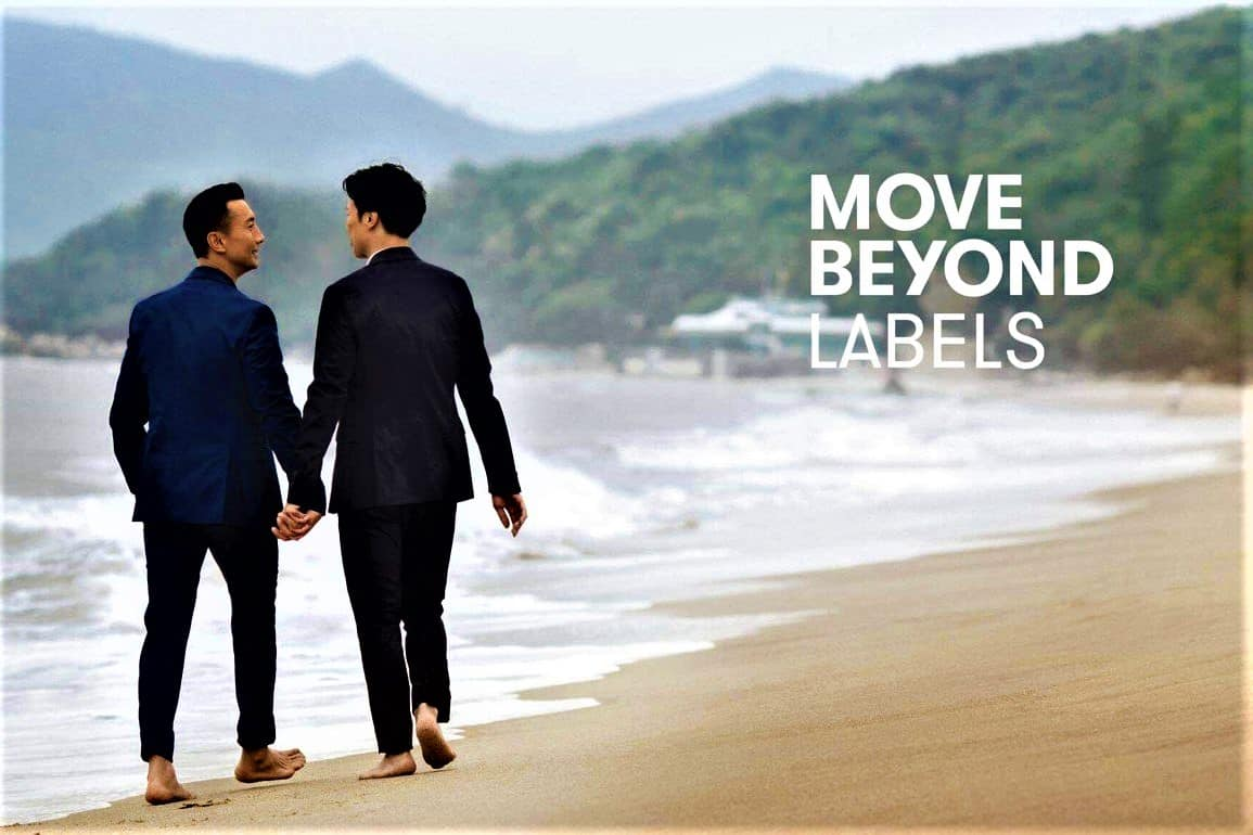 two-men-holding-hands-on-a-beach-in-hong-kong
