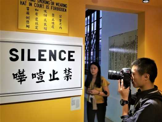 photographer-photographing-tai-kwun-101-signage