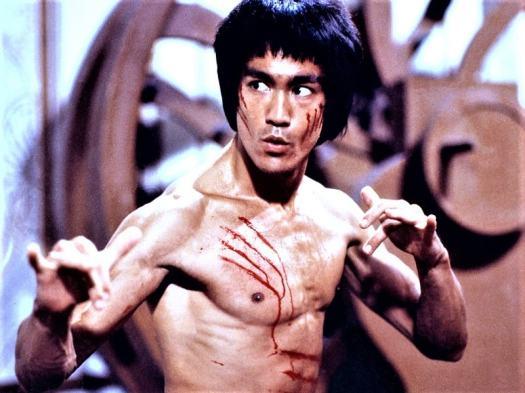 bruce-lee-striking-a-pose-in-kung-fu-movie