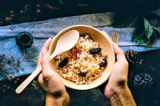thai-rice-dish-eatern-wtih-fork-and-spoon