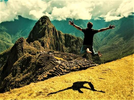 man-jumping-in-the-air-overlooking-machu-picchu