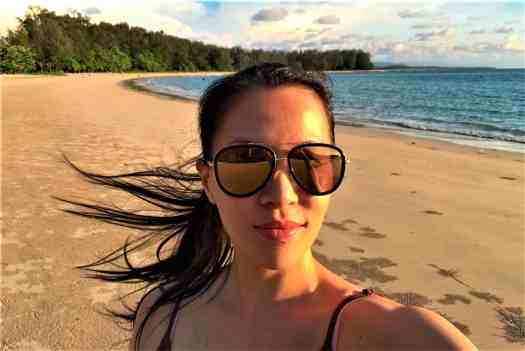 woman-in-sunglasses-on-beach-in-phuket
