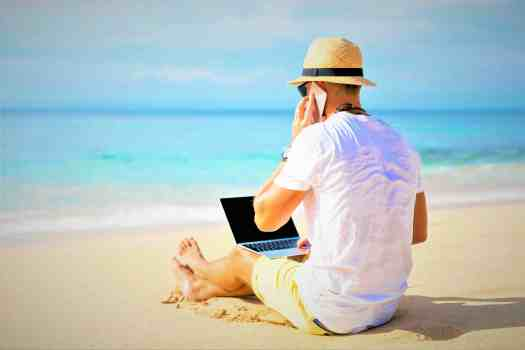man-on-beach-with-computer
