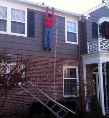 Hanging Christmas lights and falling