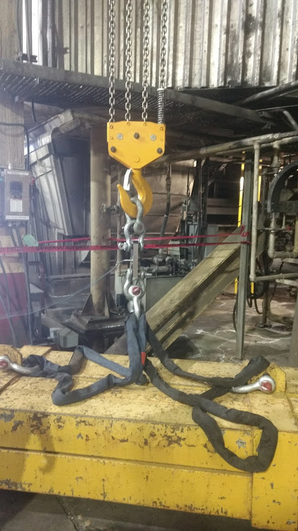 Hook and nylon sling lifting test weights inside a power plant in saskatchewan