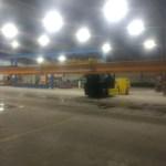 large forklift installing factory crane