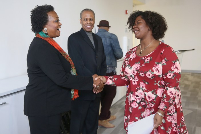 Linda Wright Moore, widow of Acel Moore, left, shakes hands with Ebony Graham during the Acel Moore High School Journalism Workshop awards luncheon at the Philadelphia Media Network office in Center City on Saturday, April 7, 2018. The luncheon honored the 21 students who participated in this year's workshop. TIM TAI / Staff Photographer