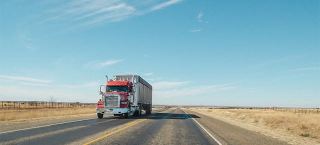 Truck of Manville movers on an open road