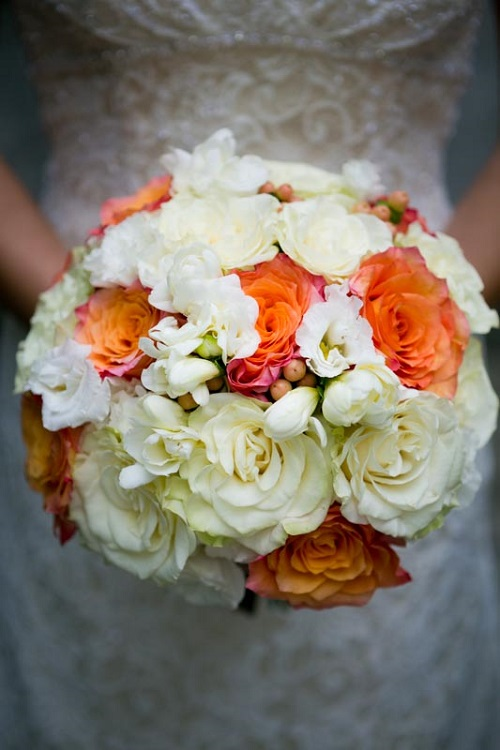 Wedding flower ideas for outdoor weddings colorful bridal bouquet with orange and cream roses green button and spider mums green hydrangea accented with black viburnum berries mightylinksfo