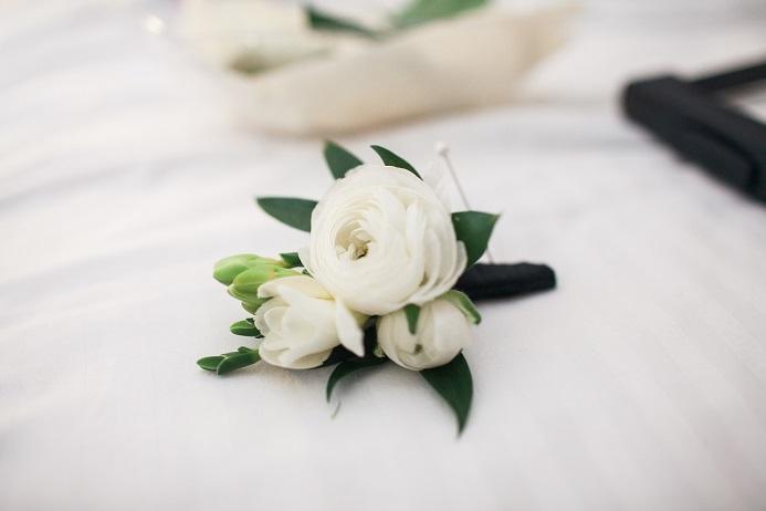 white-ranunculus-freesia-boutonniere