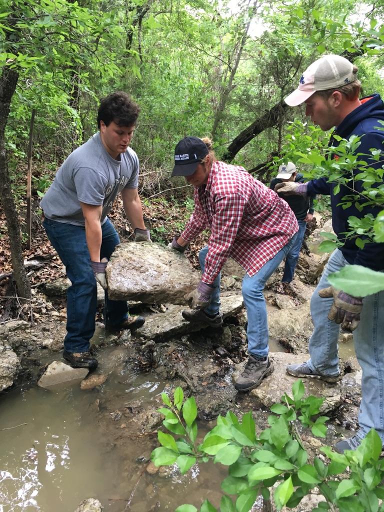 GreenServe volunteers moving rocks at Eisenhower State Park.
