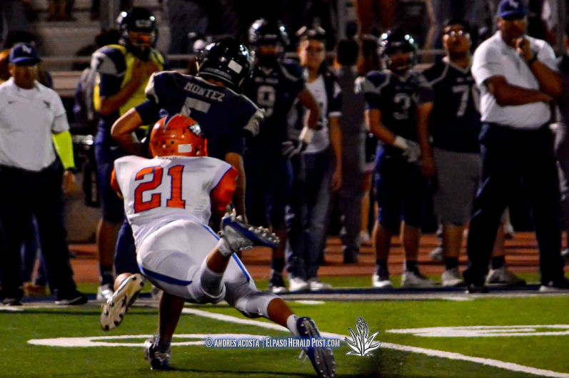 Eagles Linebacker #21 Pablo Marquez chases down Conquistadors QB Raymond Montez #5 for the QB sack during the Canutillo Eagles at Del Valle Conquistadores in a district 2-5A showdown at Conquest Stadium