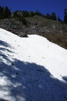 Snow melt undercuts these snow fields-- proceed with caution