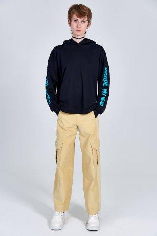 Acephala Fw 2020 21 Black Unisex Printed Hoody Yellow Corduroy Trousers Female Front