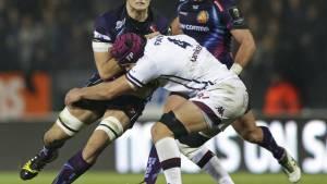 Previo al placaje. Rugby.